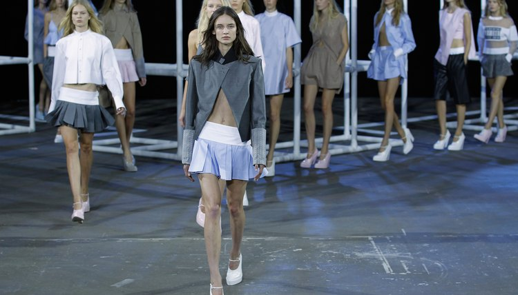 Chunky shoes and a jacket offset super short, pleated miniskirts if you don't wish to flaunt too much skin.