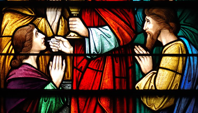 Stained glass of apostles around Jesus.