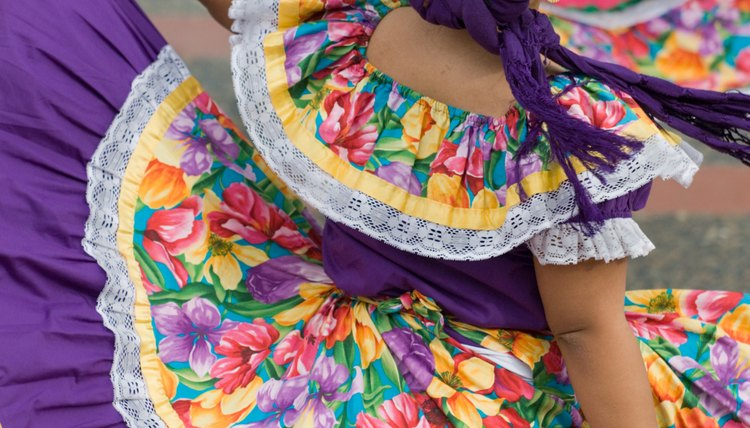Mexican dancers perform outside.