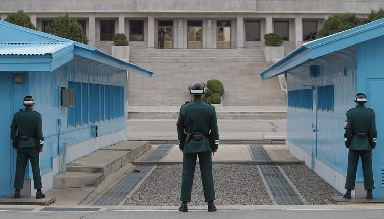 South Korean soldiers stand guard at the border village of Panmunjom between South and North Korea at the Demilitarized Zone (DMZ) on April 23, 2013 in Panmunjom, South Korea.