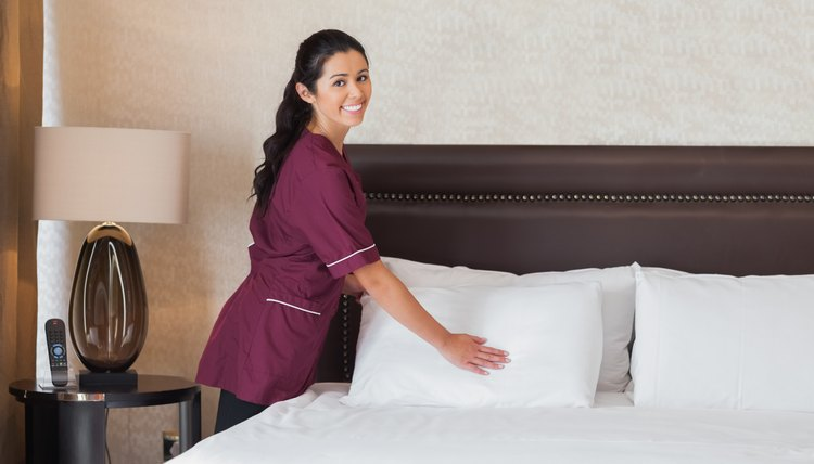 Happy hotel maid at work
