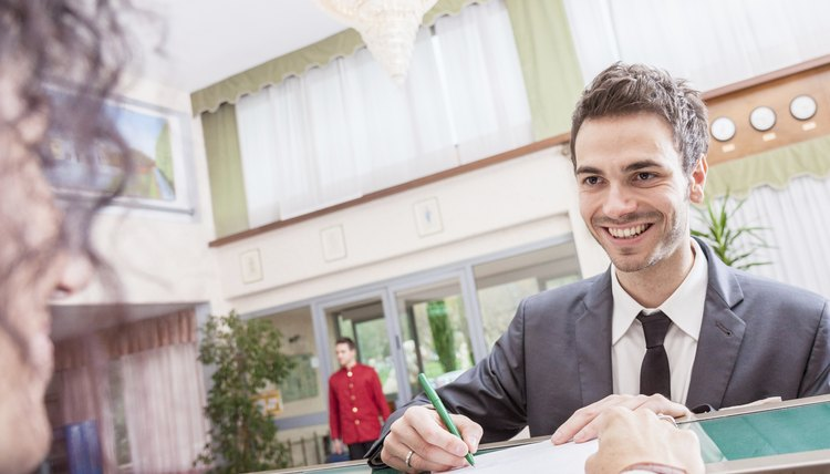 Marvelous Businessman Checking In At The Reception Desk