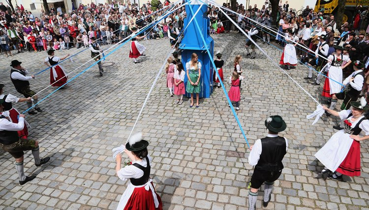 Dancing around the maypole is a cherished German tradition.