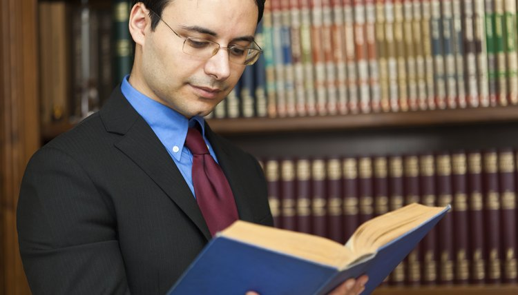 Lawyer reading from legal book