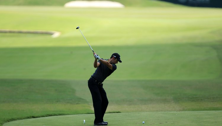 Schwartzel finishes his backswing by simply swinging his arms to the top.