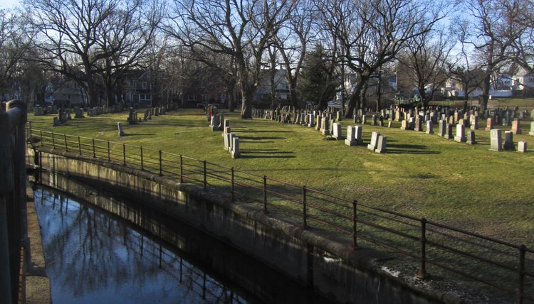 A brook runs along a cemetery.