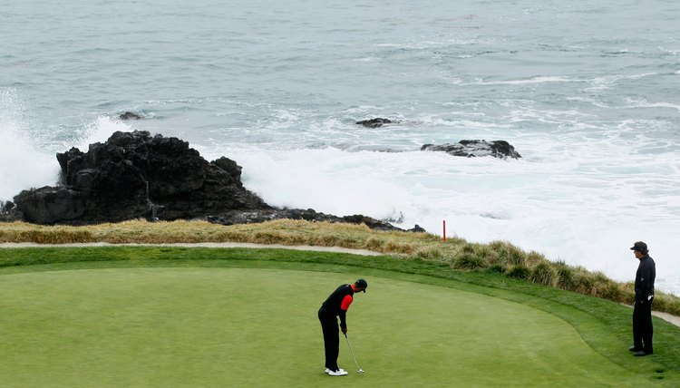 Phil Mickelson watches Tiger Woods putt on Pebble Beach's seventh green during the 2012 AT&T National Pro-Am.