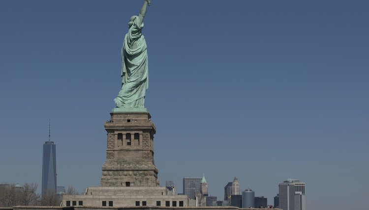 The Statue of Liberty is a symbolic welcome but the USCIS controls access to the country.