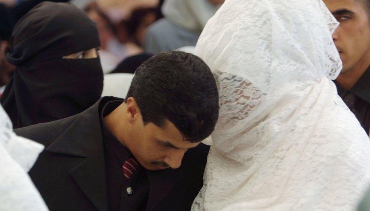 Veiled Muslim bride and groom