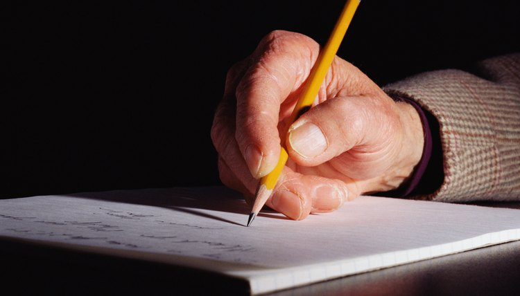 Man's hand wriitng with pencil