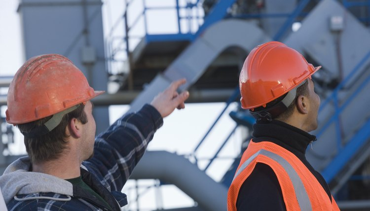 Two engineers discussing at an asphalt plant