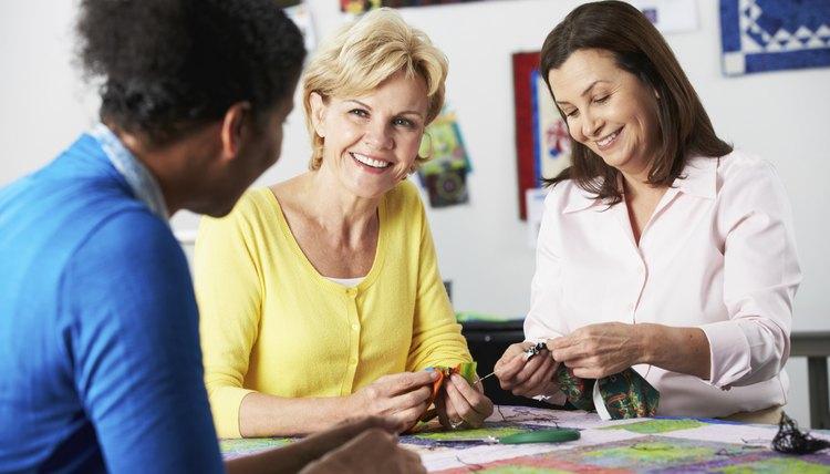 Women making quilt