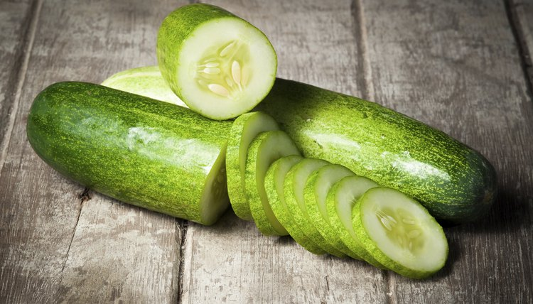 cucumber slices on wooden background