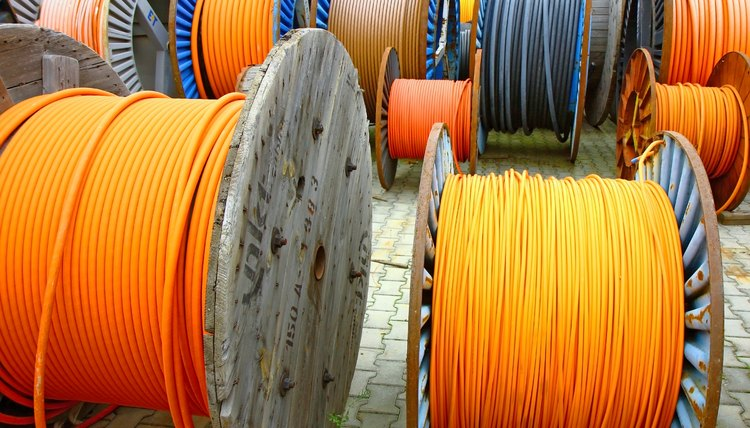 wires of electrical cable on wooden spool