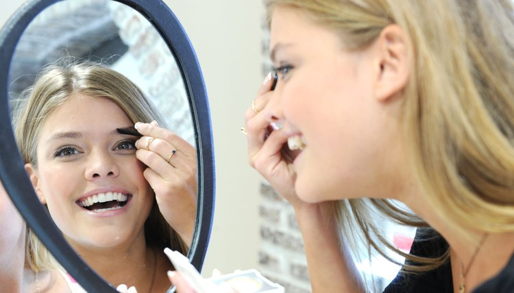 Use tweezers to sculpt your brows at home.