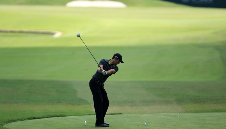 Unlike McIlroy, Schwartzel's right elbow bends early and his wrists set by the time his left arm is parallel to the ground.