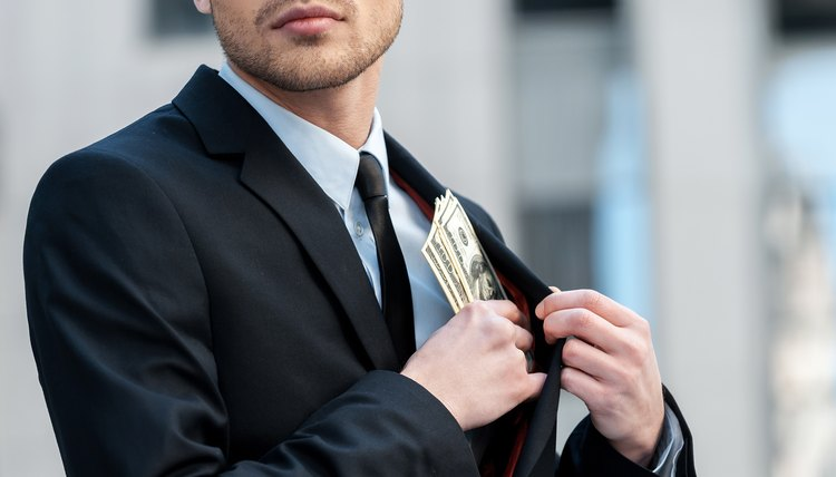 Man pocketing company money