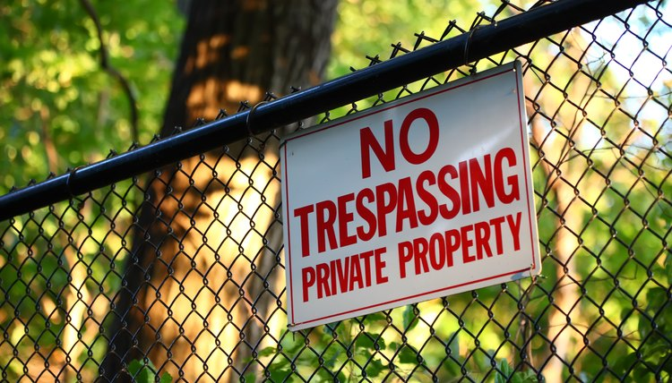 No trespassing private property sign on a fence