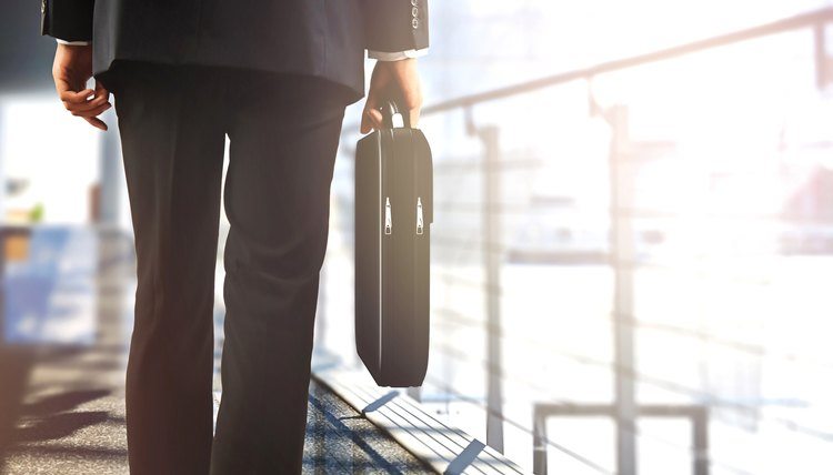 Businessman with briefcase on a walkway