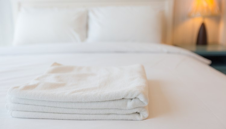 Towels on bed in guest bedroom