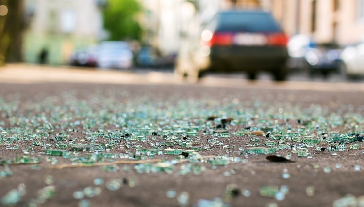 Shards of car glass on the street after a car accident