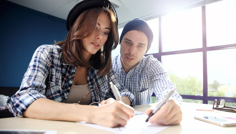 Young couple filling out quitclaim deed form