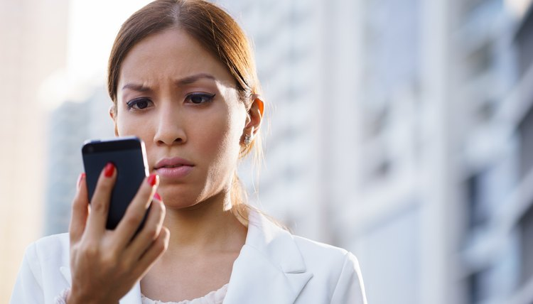 Woman reading text messages on her phone