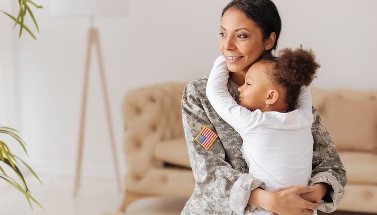 Military mom and daughter hugging
