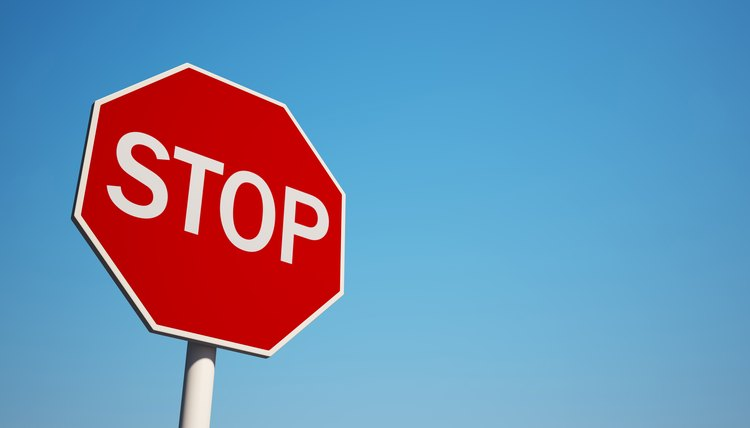 Photo of a stop sign with blue sky background