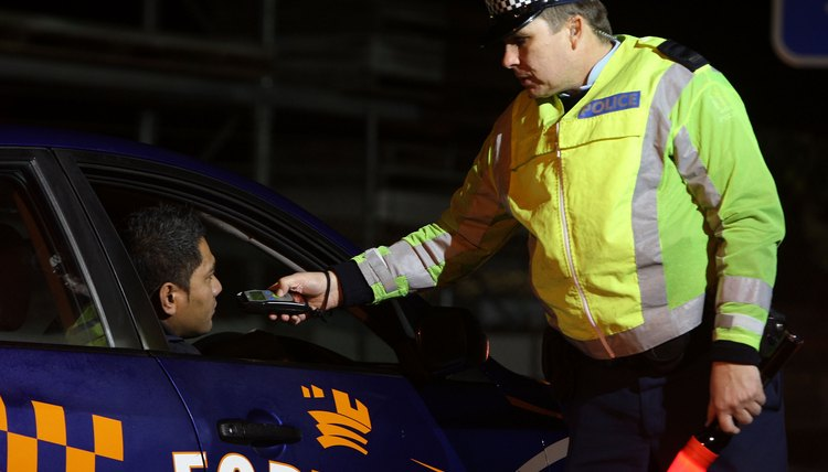 Police Stop Motorists At Drink Driving Check Point In Auckland