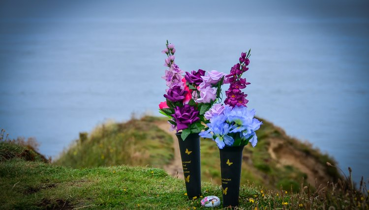 Flowers on the sea shore in remembrance