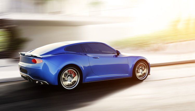 blue sports car driving on urban scene
