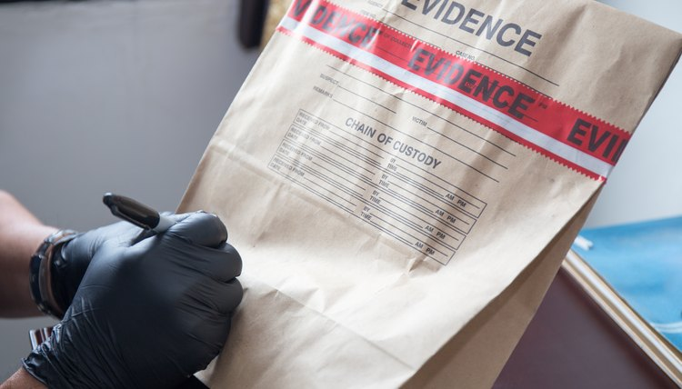hand in glove writing on sealed evidence bag
