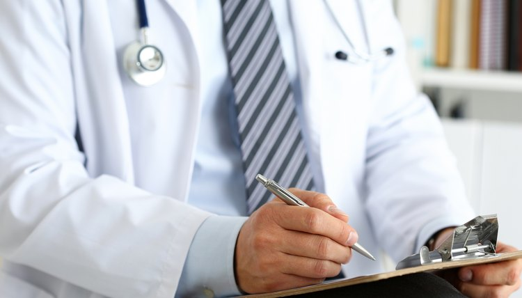 Doctor writing a note for a patient