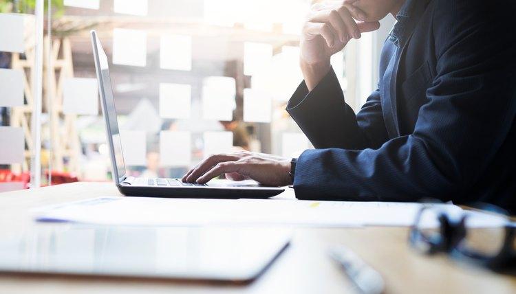 Man checking status of work permit online