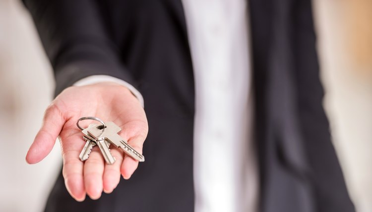 Landlord holding keys to property