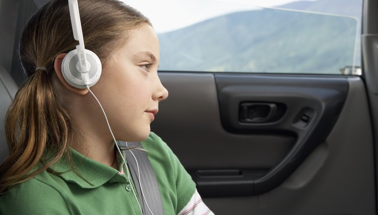 Girl in car wearing headphones