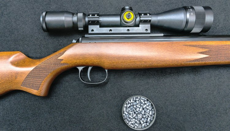 BB gun with wooden butt, scope and pellets