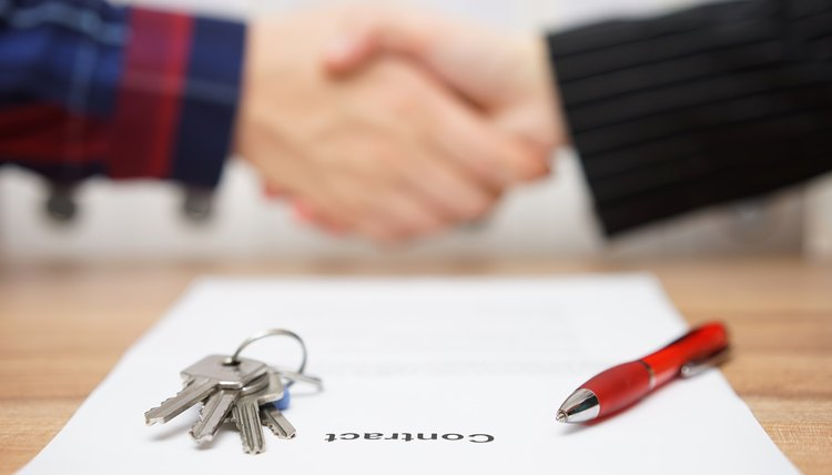 business partners are handshakings after finished real estate deal,