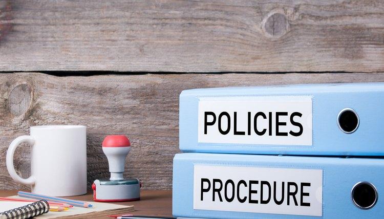 Policies and Procedure binders on desk