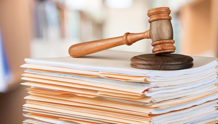 Legal folders under a judge's gavel