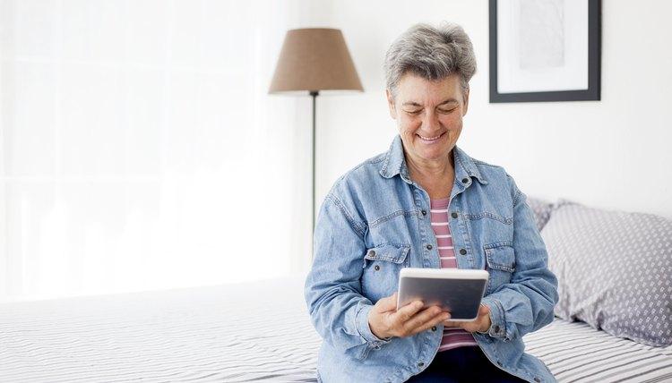 senior woman using digital tablet