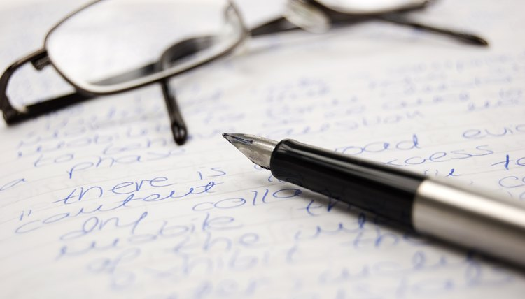 Pen and glasses on a handwritten letter