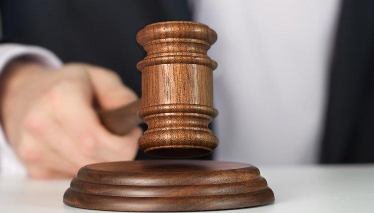 Judge holding wooden gavel