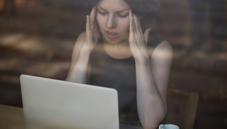 Woman upset, looking at laptop computer