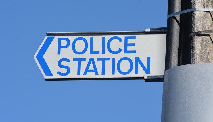 Police Station Sign against blue sky