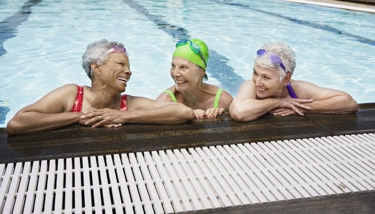 Smiling senior women in pool