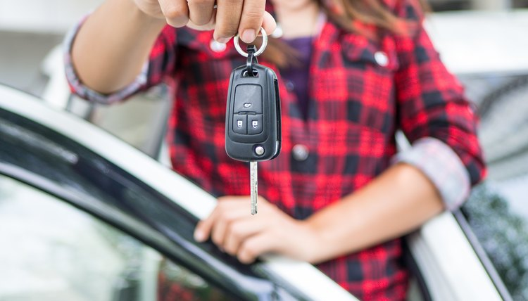 Girl holding the keys to a new car