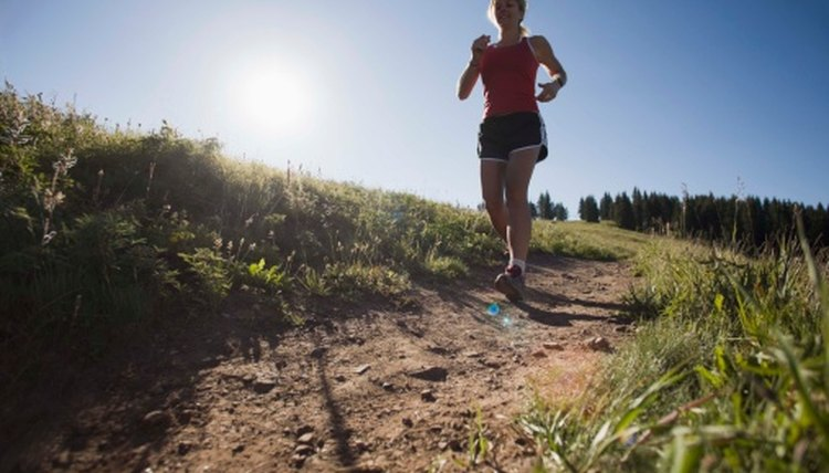 What Causes Leg Soreness When Running Downhill?