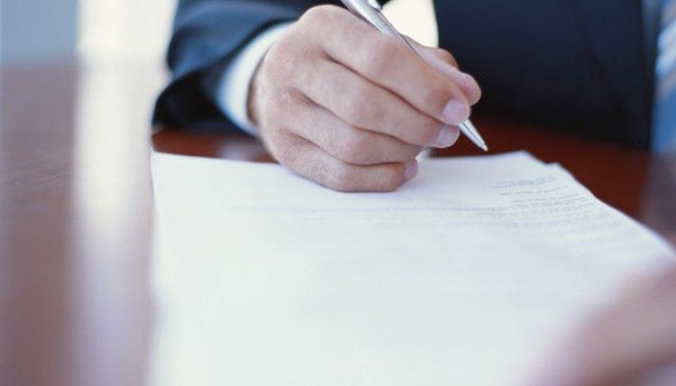Man signing transfer deed.